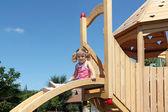 Beauty little girl on playground — Stock Photo