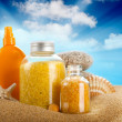 Sunbath - suntan oil and spa minerals — Stock Photo