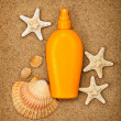 Summer beach - suntan oil — Stock Photo