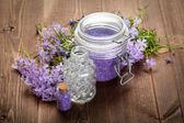 Spa still life - bath salt and spring flowers — Stock Photo