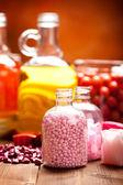 Pink bath salt and essential oils — Stock Photo