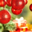 Christmas background - gifts, tree and baubles — Stock Photo