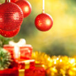 Royalty-Free Stock Photo: Christmas background - baubles, spruce tree and gifts