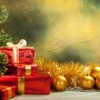 Christmas background - golden balls and gifts — Stock Photo