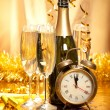 New Year - champagne, decoration and clock face — Stock Photo