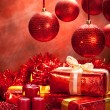 Christmas decoration - gifts, balls and candles — Stock Photo