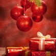 Christmas background - decoration red balls and gifts — Stok fotoğraf