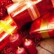 Gifts and candles - christmas decoration — Stock Photo