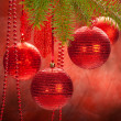 Christmas decoration - red balls and spruce branch — Stok fotoğraf