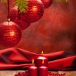 Christmas decoration - red baubles and candles — Stock Photo