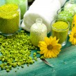 Yellow flowers and green bath salt — Stock Photo