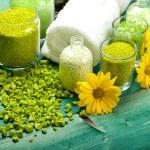 Yellow flowers and green bath salt — Stock Photo