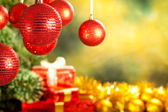 Christmas background - baubles, spruce tree and gifts — ストック写真