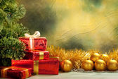 Christmas background - golden balls and gifts — Stockfoto