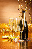 Happy New Year - champagne and party decoration — Stock Photo