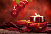 Christmas background - decoration red balls and gifts — Stock Photo