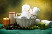 Towels and green bath salt — Stock Photo