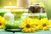 Yellow flowers and bath salt — Stock Photo