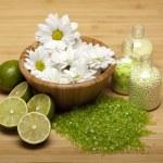 Aromatherapy - Flowers and lime bath salt — Stock Photo