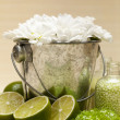 Lime bath salt and flowers — Stock Photo