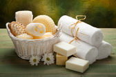 Spa - white towels, soap and massage accessory — Stock Photo