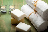 Soap and white towels — Stock Photo