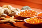 Starfish and orange bath salt — Stock Photo