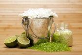 Flowers and Lime bath salt — Stock Photo