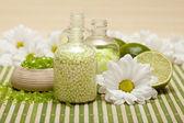 Spa - flowers, bath salt and ripe limes — Stock Photo