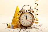 Clock and party decorations — Stock Photo