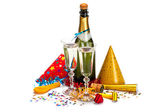 Party - champagne, caps, confetti and streamers — Stock Photo