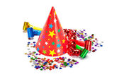Party decoration - caps, confetti and streamers — Stock Photo