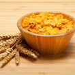 Corn flakes and wheats — Stock Photo