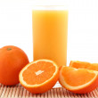Orange juice on bamboo matting — Stock Photo