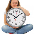 Female student with big clock — Stock Photo