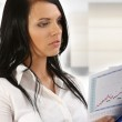 Businesswoman viewing stock charts — Stock Photo #6574676