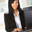 Young businesswoman working in office — Stock Photo #6575411
