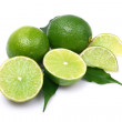 Green limes on white background — Stock Photo