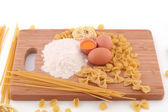 Macaroni, flour and eggs — Stock Photo