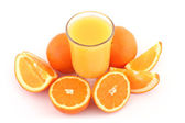 Orange juice and ripe oranges — Stock Photo