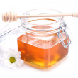 Jar of honey , dipper and flower - Stock Photo