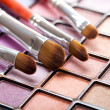 Eye shadows palette and professional brushes — Stock Photo
