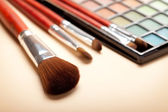 Make up - brushes and eye shadows palette — Stock Photo