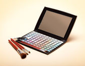 Palette of colorful eye shadows and make up brushes — Stock Photo