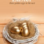Easter eggs - three golden eggs in the nest — Stock Photo