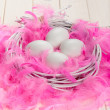Stock Photo: White eggs, pink plumes