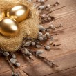 Easter golden eggs in the nest — Stock Photo