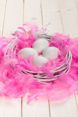 White eggs, pink plumes — Stock Photo