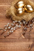 Easter golden eggs in the nest — Stock Photo