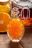 Orange bath salt and jar of honey — Stock Photo